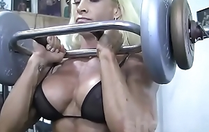 Blonde Female Bodybuilder in Remark Thru Top Works Widely Hard