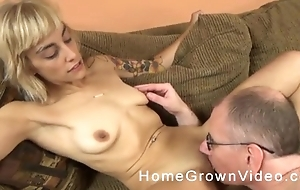 Horny old man with glasses copulates blonde chick on the couch