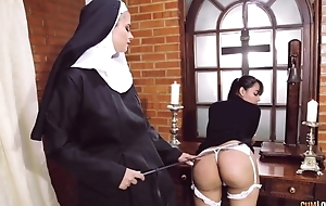 Perverted nun bonks her girlfriend with strapon dildo