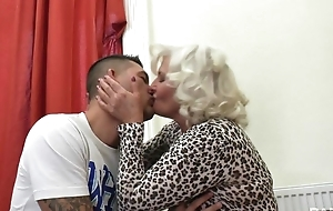 Perverted granny in stockings plus high heels shagged on eradicate affect couch