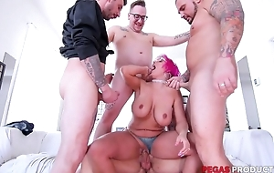 Pink-haired mature with glasses serves three hard cocks at once