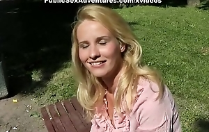 Appealing natural blonde banged outdoors